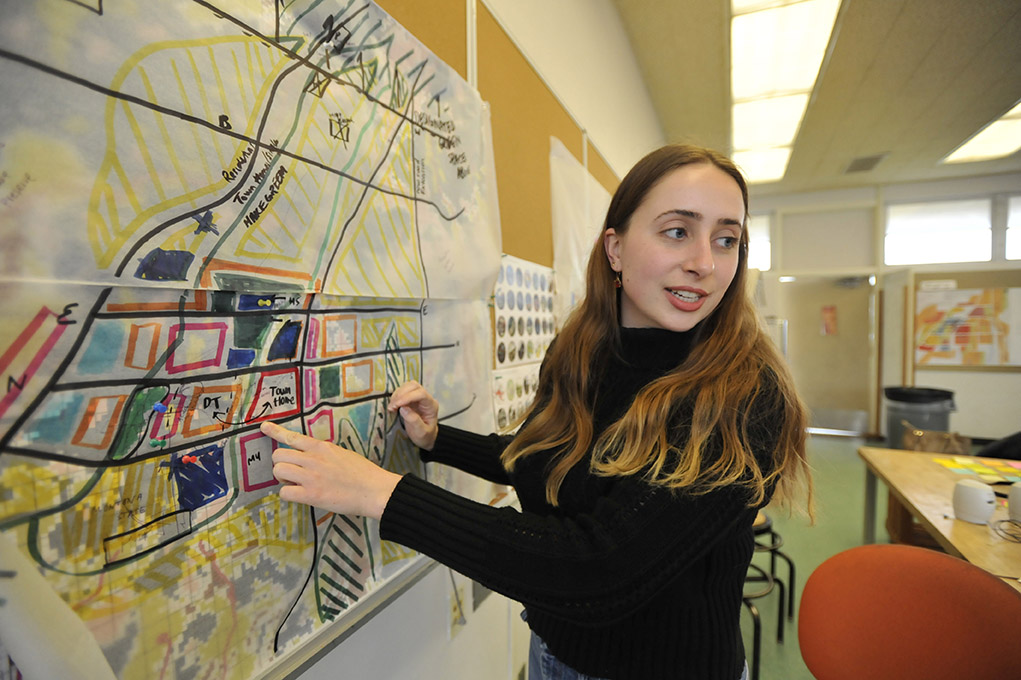Cal Poly architecture student Katherine Young points to a proposed zoning map of Paradise showing where future uses could be located.